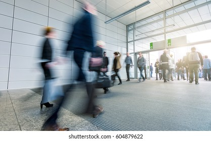 blurred Business people walking in the trade fair corridor