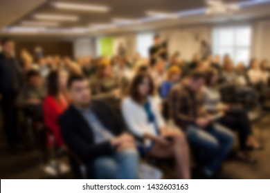 Blurred business seminar meeting in the conference hall. Defocused people background.