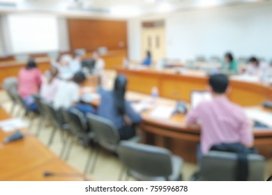 Blurred of a business woman in blue suit present with smartboard in meeting room.