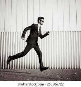 Blurred Businessman running fast to the office.