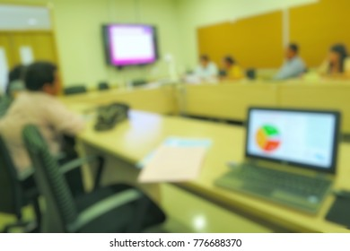 Blurred of a businessman in white shirt present with smartboard in meeting room. Business, Education and technology concept.
