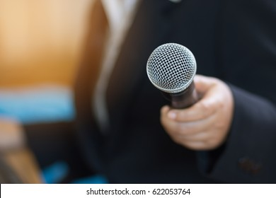 blurred of businesswoman speech and reporter with microphone at presentation in conference meeting room. Seminar Concept.