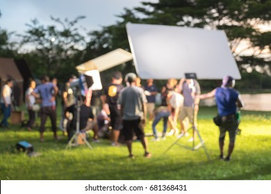 Blurred Busy outdoor filming production crew team