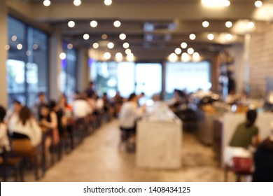 Blurred cafe interior with people. Modern coffee house blur background.