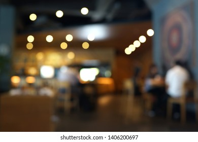 Blurred cafe interior with some people on a background. Coffee house blur background.