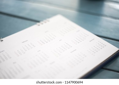 Blurred calendar in dark tone.