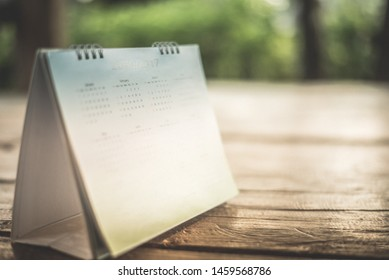 Blurred calendar in dark tone.