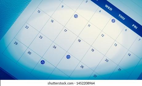 Blurred calendar on blue tone.