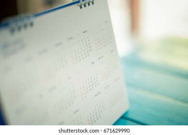 blurred calendar on blue tone.