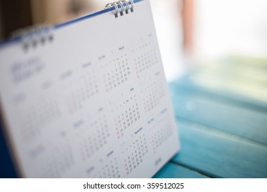 Blurred calendar page blue background.