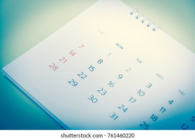 Blurred calendar in planning concept in blue tone.