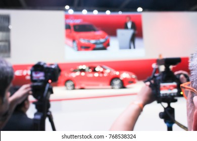 Blurred  camera at a  press conference and mass media reporter at the car event motor show
