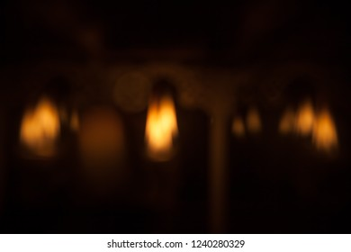 Blurred candle lights, spirituality, remembrance, sorrow concept