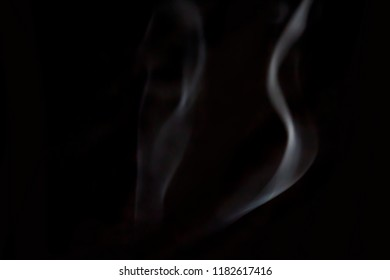 blurred candle smoke over dark background for your abstract design.