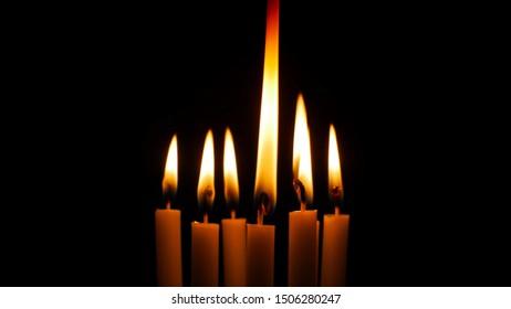 Blurred candles light on black halloween background.