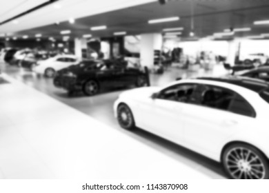 Blurred car dealership store bokeh background, Cars soft lightning, Blur bokeh transportation concept dealer showroom background. Blurry. Black and white