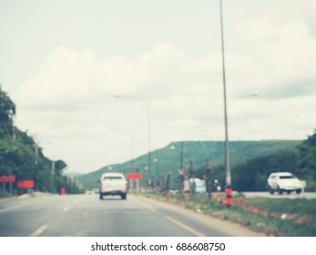 Blurred of car on road
