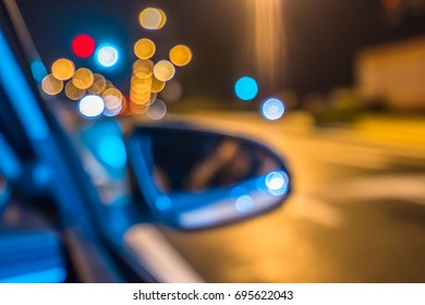 Blurred car on the street at night. Great background blur