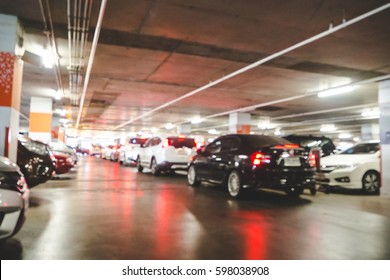 Blurred of car parking in shopping center