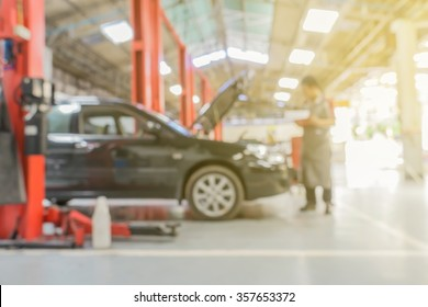 Blurred of car technician repairing the car in garage background.vintage color.