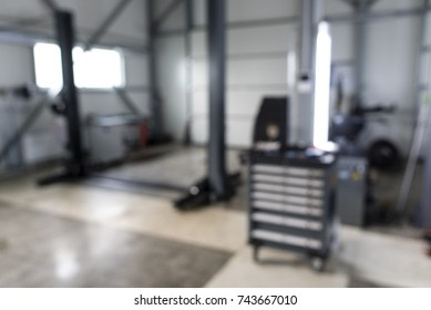Blurred of car technician repairing the car in garage background, Interior of a car repair station