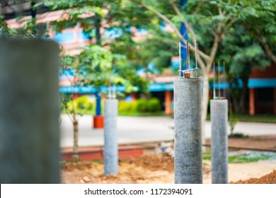Blurred cement concrete pole building in site construction
