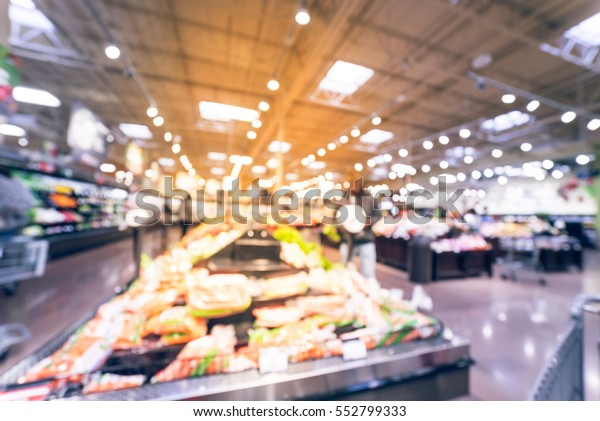 Blurred certified organic fresh produces, vegetable on shelves in local store at Humble, Texas, US. Customer shopping for carrot, onion, kale, celery and fresh fruits. Healthy lifestyle. Vintage tone