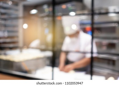 Blurred of Chef in hotel or restaurant kitchen cooking for party