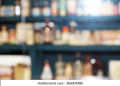 Blurred chemicals and laboratory utensils on shelves