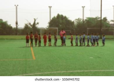 Blurred Children's Football Team in field for soccer game