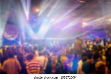 Blurred of Christian Congregation Worship God together in Big Church hall in front of music stage and light effected. Christianity background