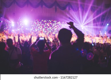 A blurred of Christian worship with raised hand,music concert