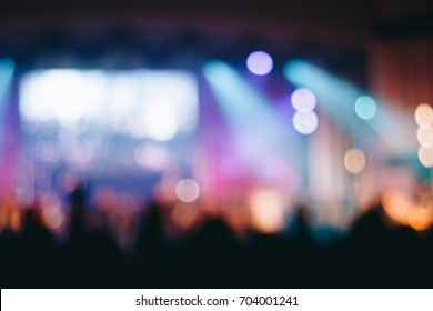Blurred of Christian worship with raised hand,music concert