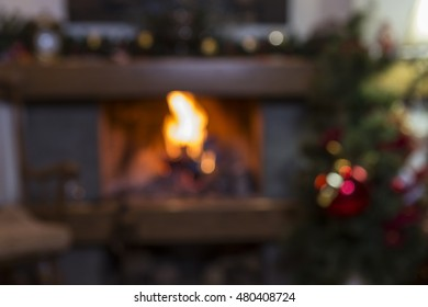Blurred christmas background of burning fireplace