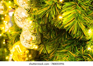 Blurred christmas ball gold on the christmas tree background,For use decoration festival and happy new year background,Soft blurred and de-focused