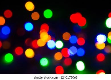 Blurred Christmas lights festive background.
