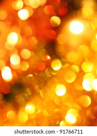 Blurred christmas lights golden background
