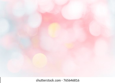 Blurred christmas snow lights on background.design effect focus happy holiday party glow texture white wall paper bokeh sun star shiny soft plain warm flare blur night light red xmas gray year