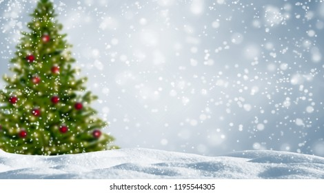 blurred christmas tree in snowy landscape