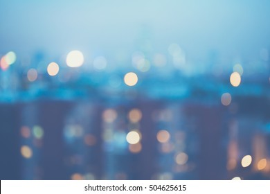 Blurred city lights background, blue color tint