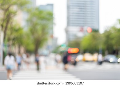 blurred city scenery with people walking at the street