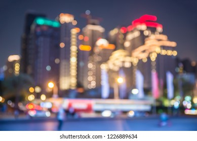 Blurred city view at night.City and tower blurred background on twilight color sky.