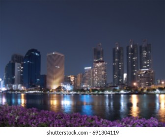 Blurred cityscape with high-rise building at night scene, Bangkok, Thailand