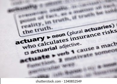 Blurred close up to the partial dictionary definition of Actuary