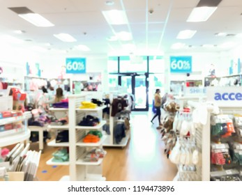 Blurred clothing store with customers in shopping mall. background picture. Concept of shopping, discount sale for holiday shopping.