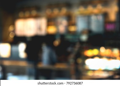 blurred of the coffee shop for background on vintage color tone.