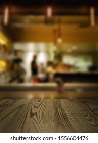 Blurred coffee shop background to promote your own coffee product. Just place your product in the middle of the frame, on the wooden bar for a pack shot