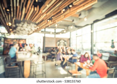 Blurred coffee shop or cafe restaurant in sunny fall morning at Dallas, Texas, US. People, customer enjoy coffe while chat, connect and work at coffee shop. Urban gathering place concept. Vintage tone