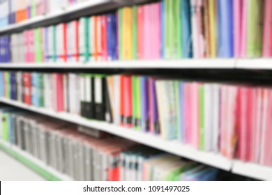 Blurred Colorful dossier on the bookshelf for backgroud.various document storage on the shelf