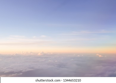 blurred colorful natural sky clouds landscape background with glowing flare light.